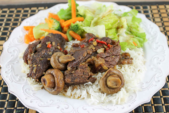 instant pot short ribs on plate with rice