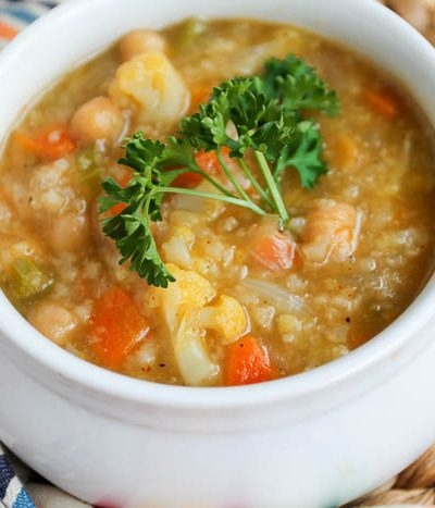 A bowl of soup, with Cauliflower and rice