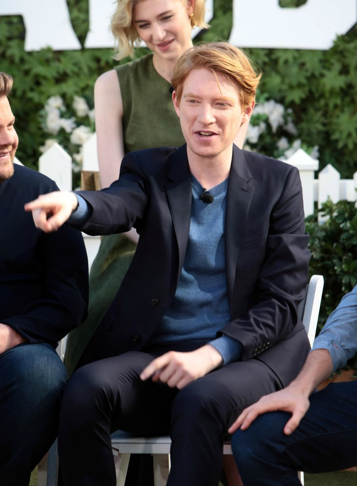Domhnall Gleeson et al. that are sitting on a bench