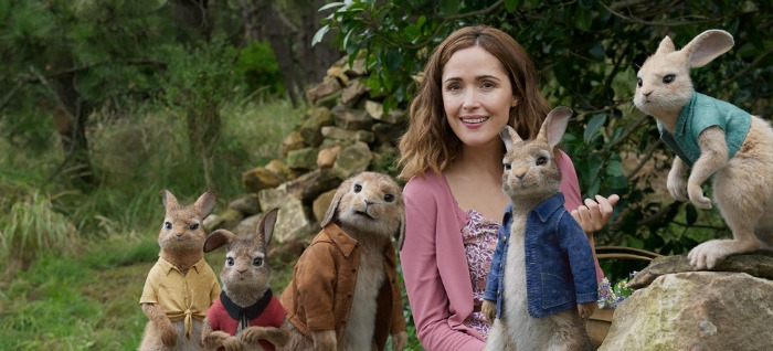 Rose Byrne et al. standing next to a stuffed animal
