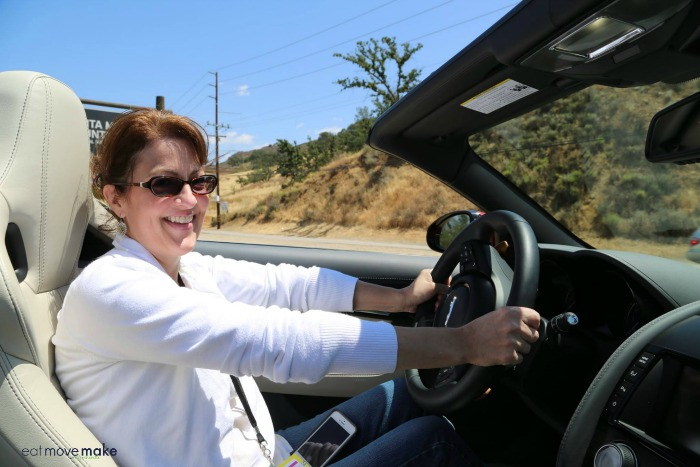 A person wearing sunglasses driving a car
