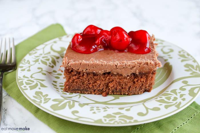 Cheerwine chocolate cake on plate with cherries