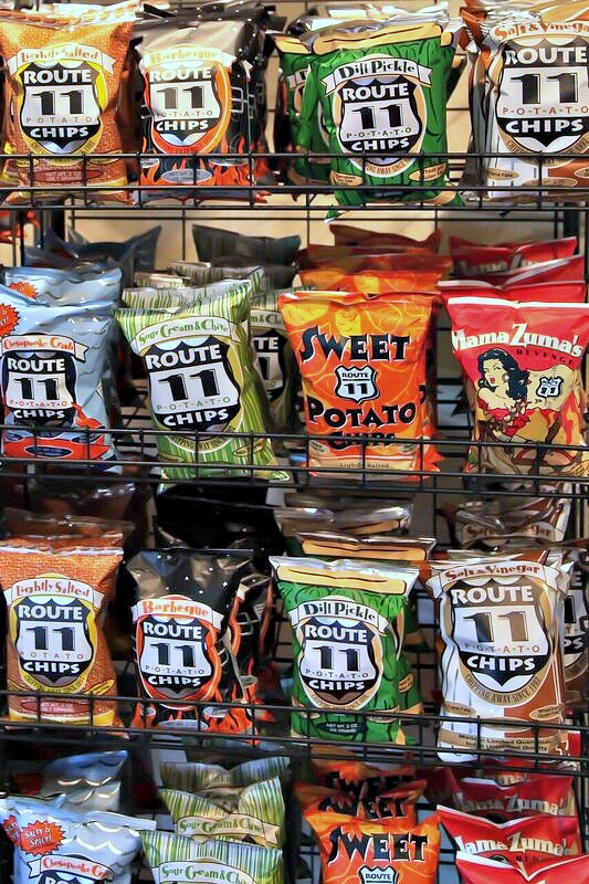 A bunch of Route 11 potato chip bags that are on display in a store