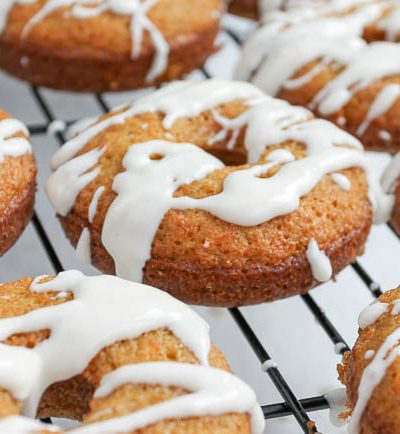 glazed carrot cake donuts on cooling rack