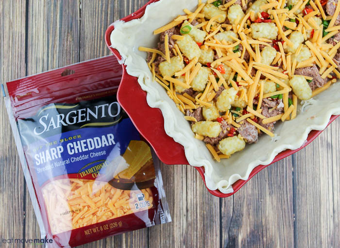add layers of corned beef, tater tots, green onions, peppers and Sargento® cheese