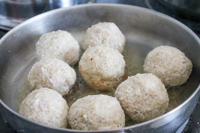 frying turkey meatballs in pan