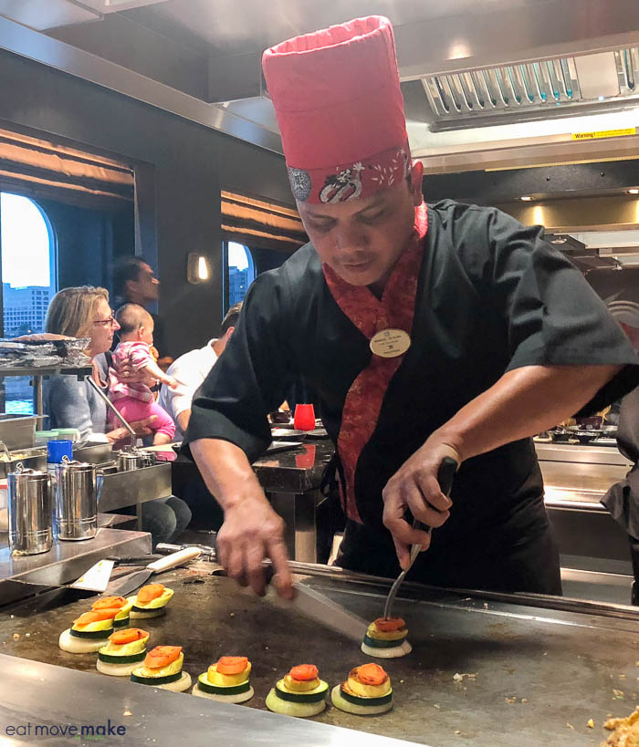 A person cooking in a kitchen at Teppanyaki