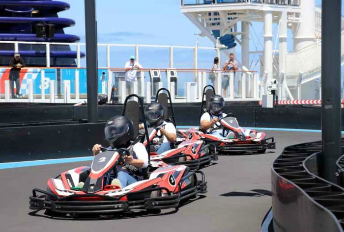 A group of people riding go-carts