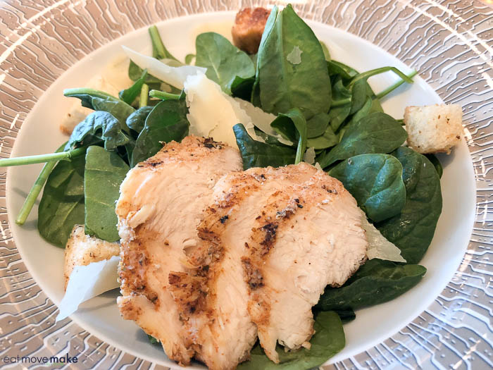chicken caesar salad on plate