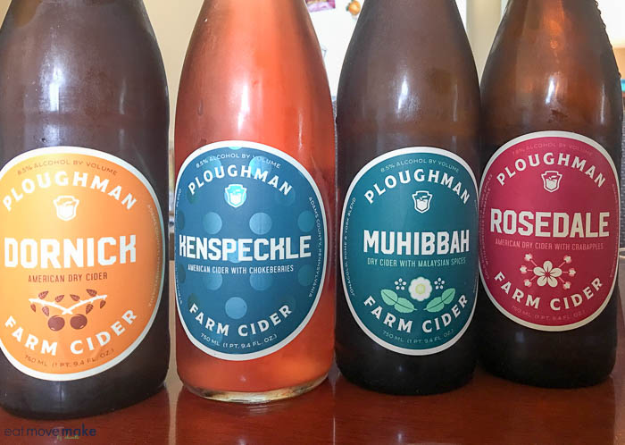 bottles of Ploughman Cider on table