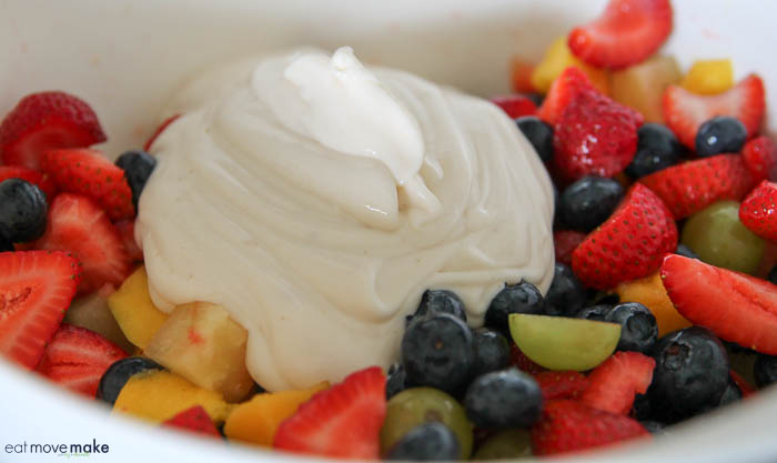 bowl of freshly cut fruit with dollop of Greek yogurt