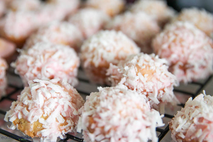coconut dusted donut bites on cooling rack