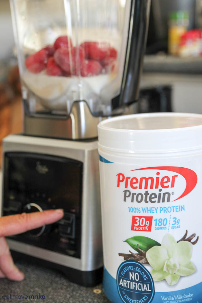 blending strawberries and protein powder in blender