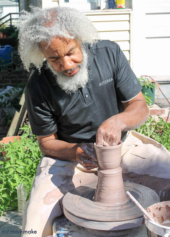 A man sitting at a pottery wheel