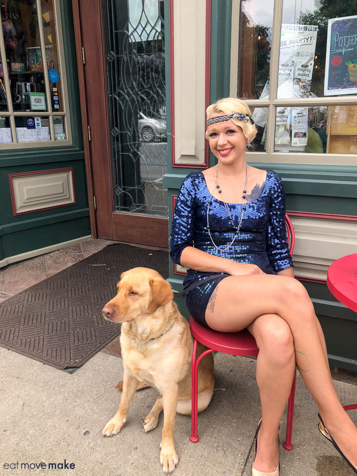 A woman sitting on a bench with a dog
