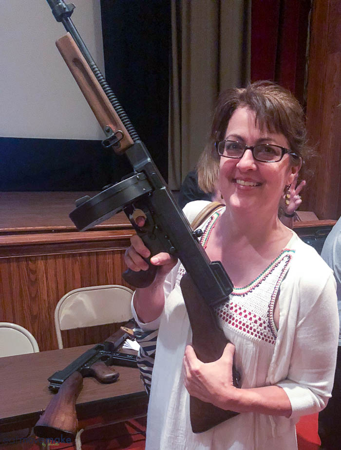 A woman holding a tommy gun
