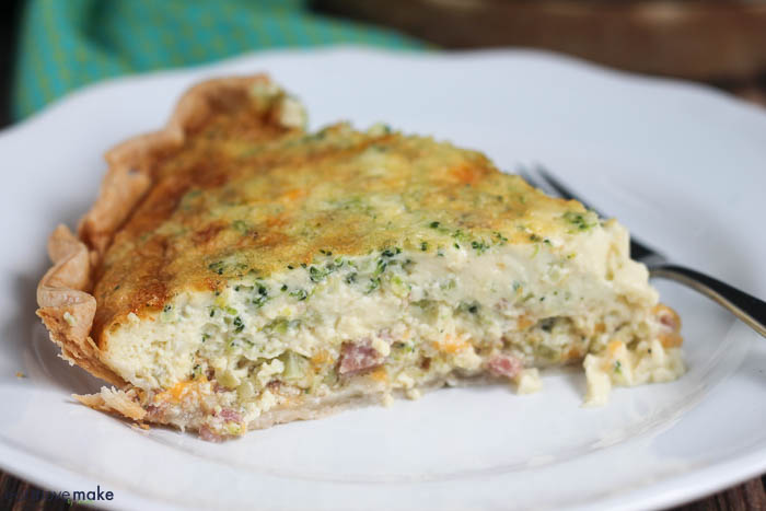 Riced Broccoli, Ham and Cheese Quiche on plate with fork