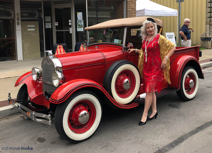 vintage car with lady standing nearby