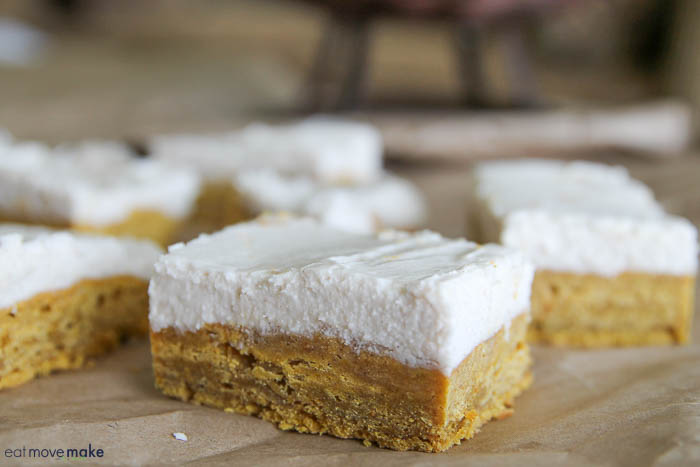 pumpkin cookie bars with cream cheese topping
