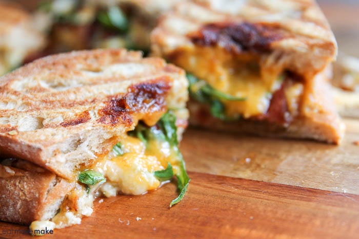 grilled cheese paninis with cheese melting out cut edge