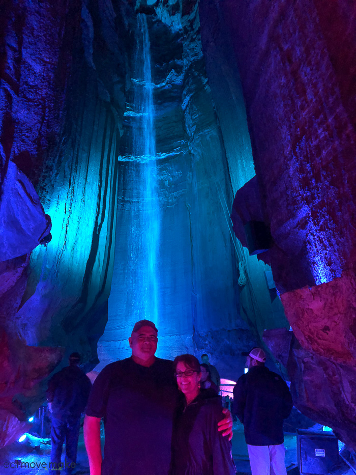 A group of people in a cavern with Ruby Falls in the background