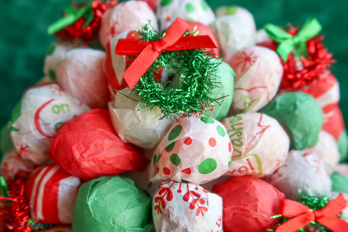 add mini decorations to candy bouquet