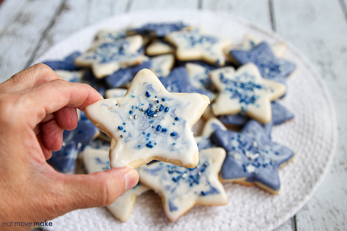 hand holding marbled star cookie