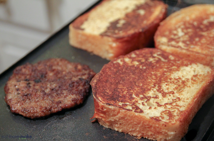 french toast slices on griddle with sausage