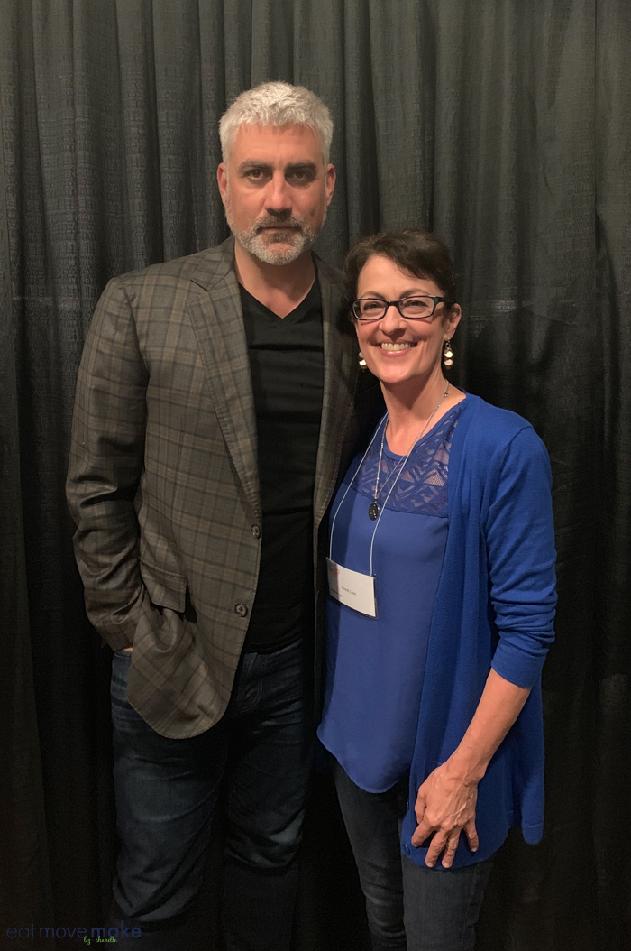 Taylor Hicks standing in front of a curtain