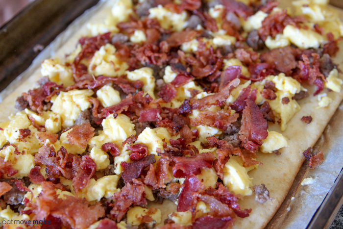 sprinkled bacon, sausage and egg on pizza crust
