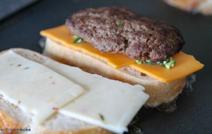A close up of a patty melt burger