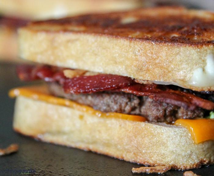 A close up of a patty melt sandwich