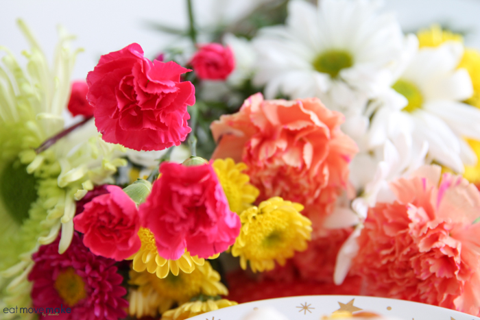 spring flowers next to plate