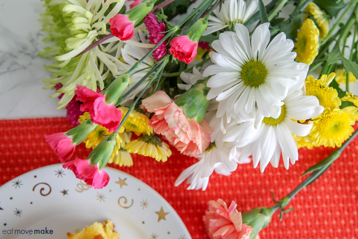 flowers next to plate of