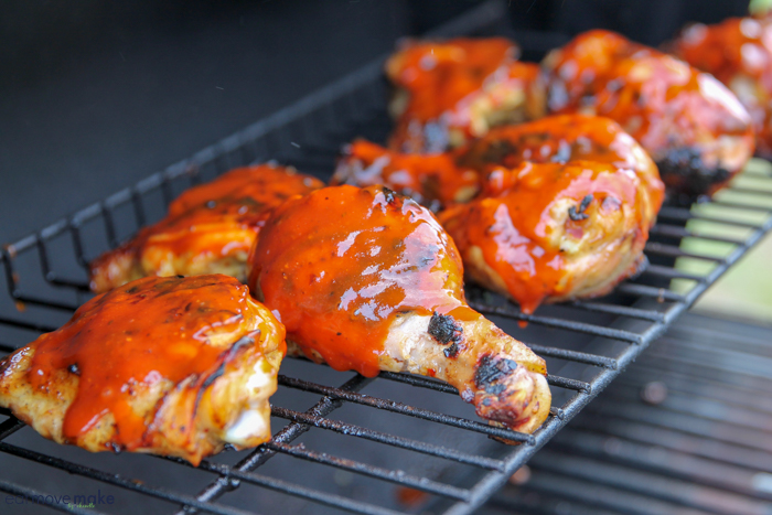 chicken coated with BBQ sauce on grill