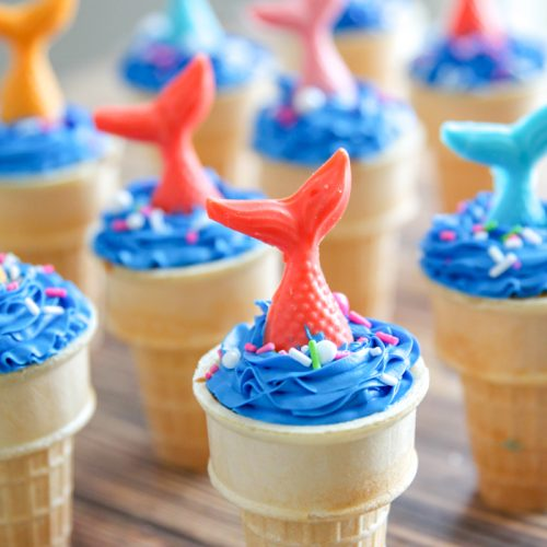 A close up of a mermaid ice cream cone cake