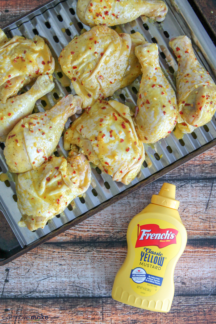 honey mustard sauce spread on chicken