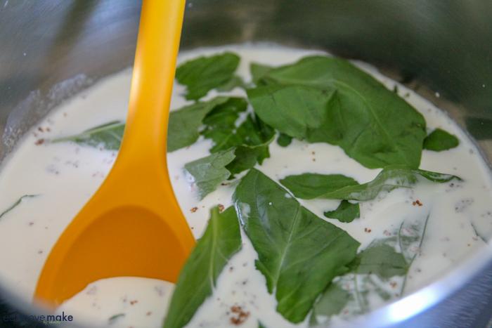 infusing basil into cream in saucepan