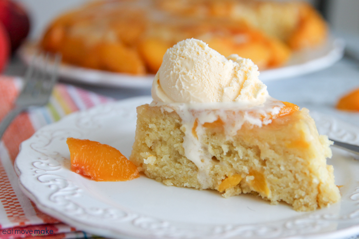 A close up of a slice of cake on a plate, with Peach