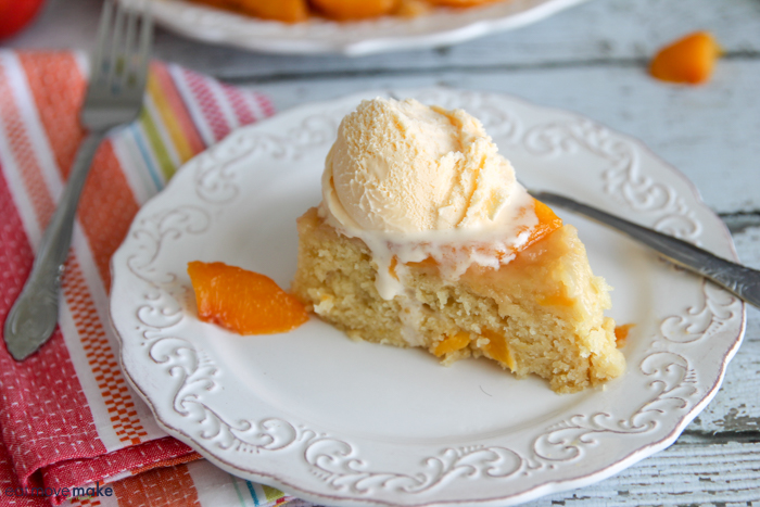 peach upside down cake on plate with fork