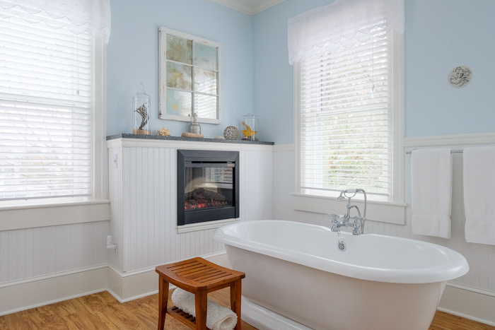 A bathroom with a sink and a window