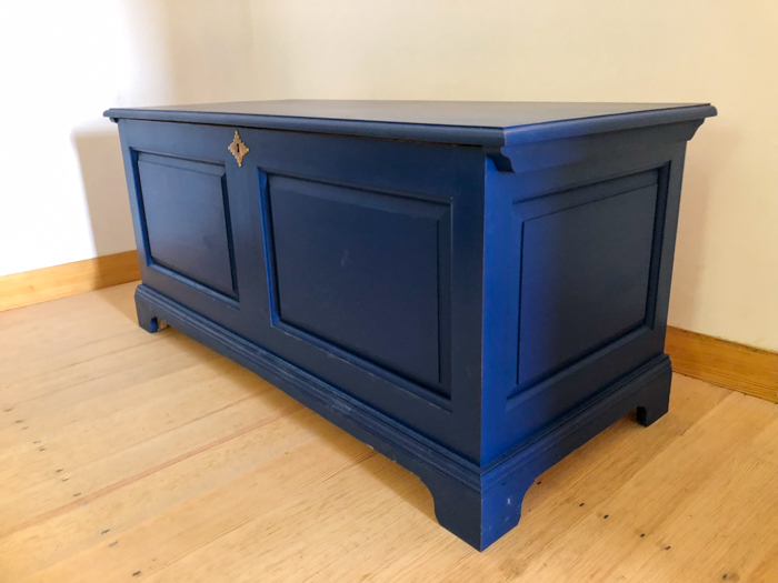 a blue wooden chest