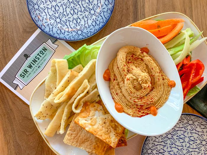 boiled peanut hummus in bowl with veggies