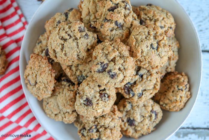 A close up of oatmeal raisin cookies on white plate
