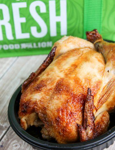 A rotisserie chicken in tray