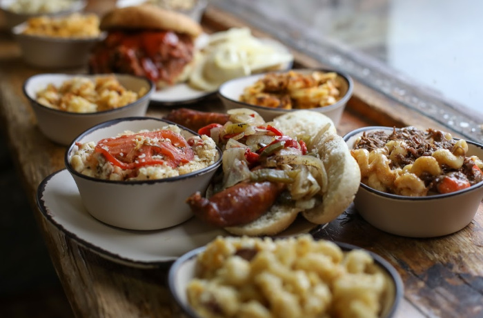 A plate of food on a table, with Autumnfest and Seven Springs