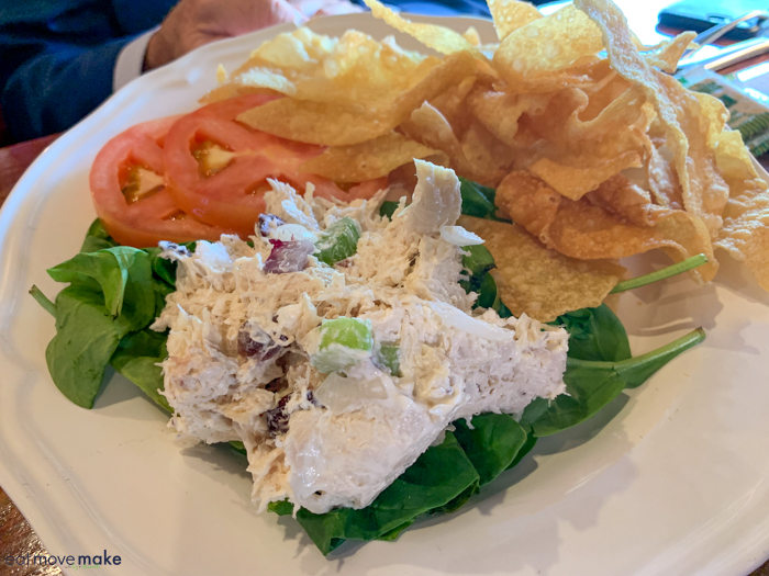 A plate of food with a sandwich and a salad