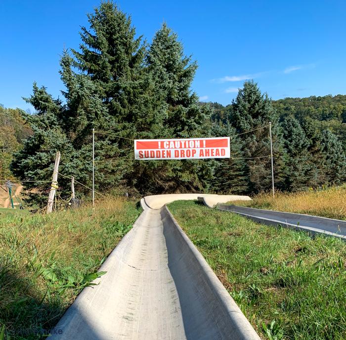 A sign on alpine slide