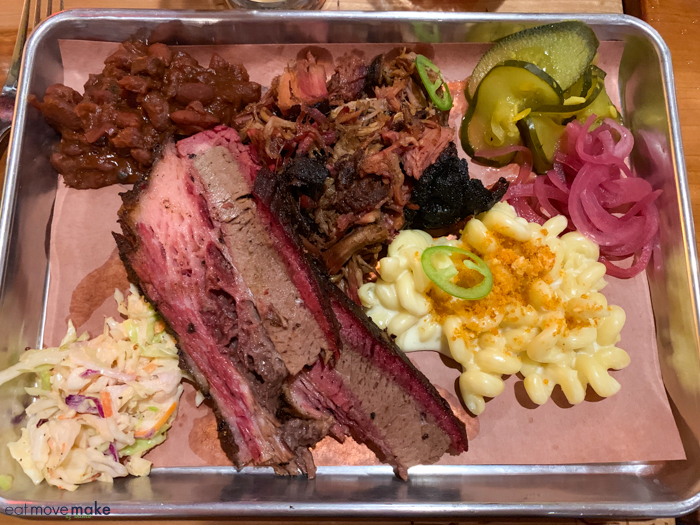 tray filled with BBQ meat and vegetables