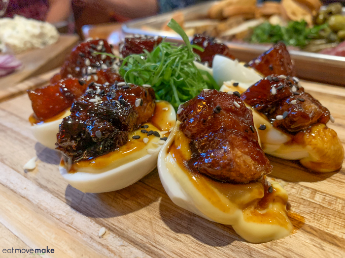 deviled eggs on a wooden cutting board